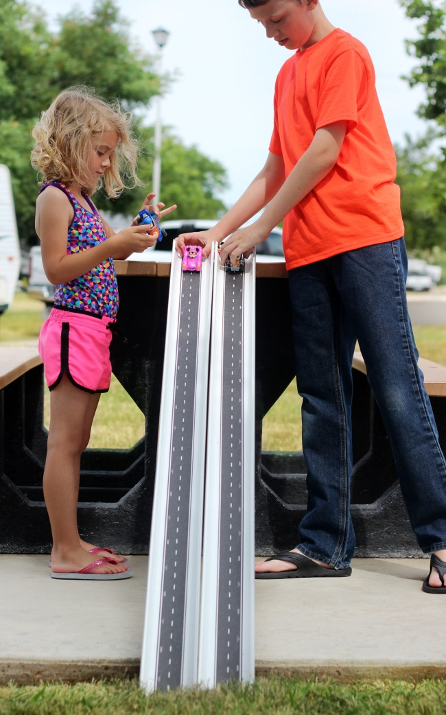 Make a $5 rain gutter race track! Snaps together for easy storage and comes together in under 10 minutes and it a fun summer activity for kids.