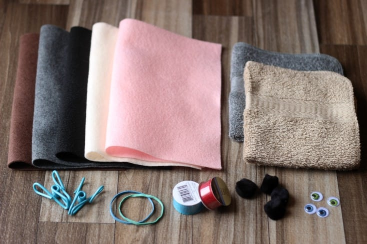 supplies for puppy wash cloth: felt, wash cloths, clips, rubber bands, ribbon, pom poms and craft eyes