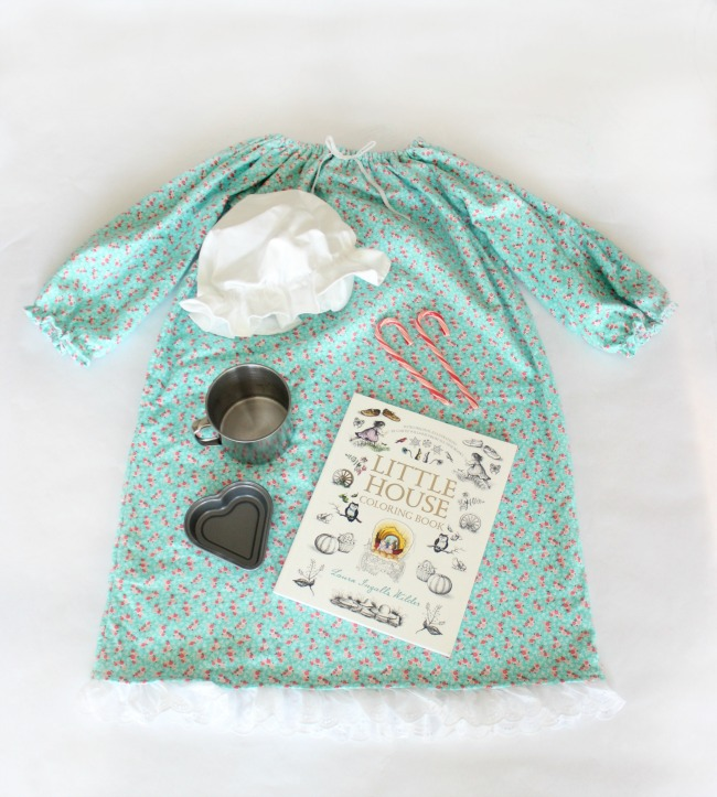 Go back in time with this darling Little House on the Prairie themed Christmas gift! Complete with a soft nightgown, night cap, tin cup, peppermint candy, mini hear pan, and a coin.