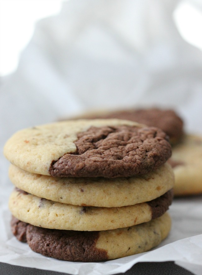When you can't decide what cookie to make, make both! These black and white cookies combine two flavors; double chocolate chip AND chocolate chip for the perfect cookie.
