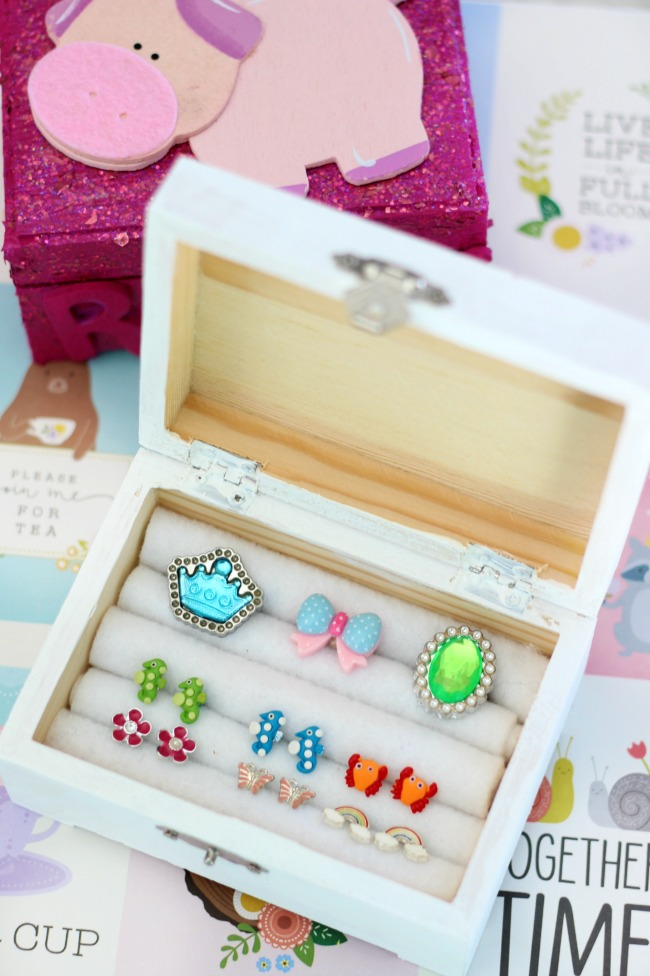 This darling DIY jewelry box is just the right size to organize earrings and rings. These $1.99 boxes are fun to paint and customize and are great for kids! Roll felt around crayons and place them close together to create the spaces for jewelry
