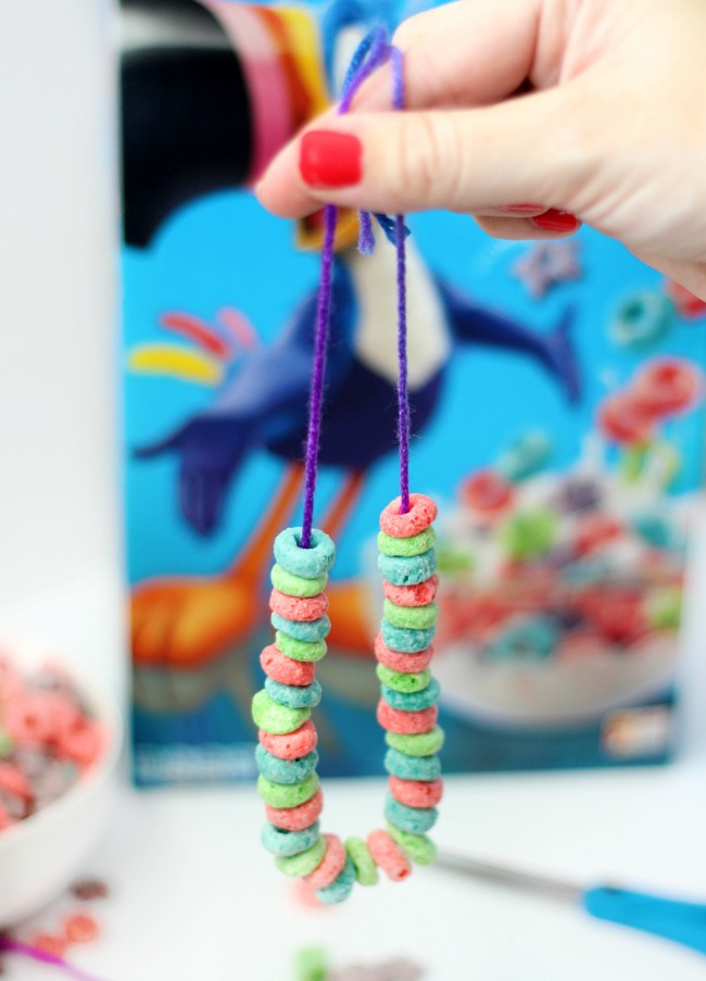 Make a Froot Loop necklace for a fun on-the-go snack to the park or the beach! A plastic yarn needle makes it even easier to string the cereal onto the yarn.