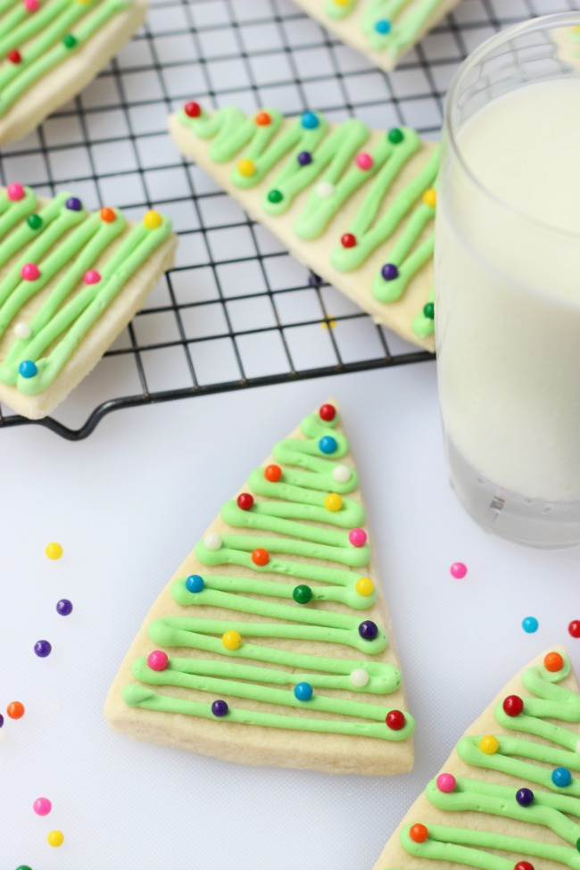 Cute and quirky triangle Christmas tree cookies that are super easy to decorate using this method!