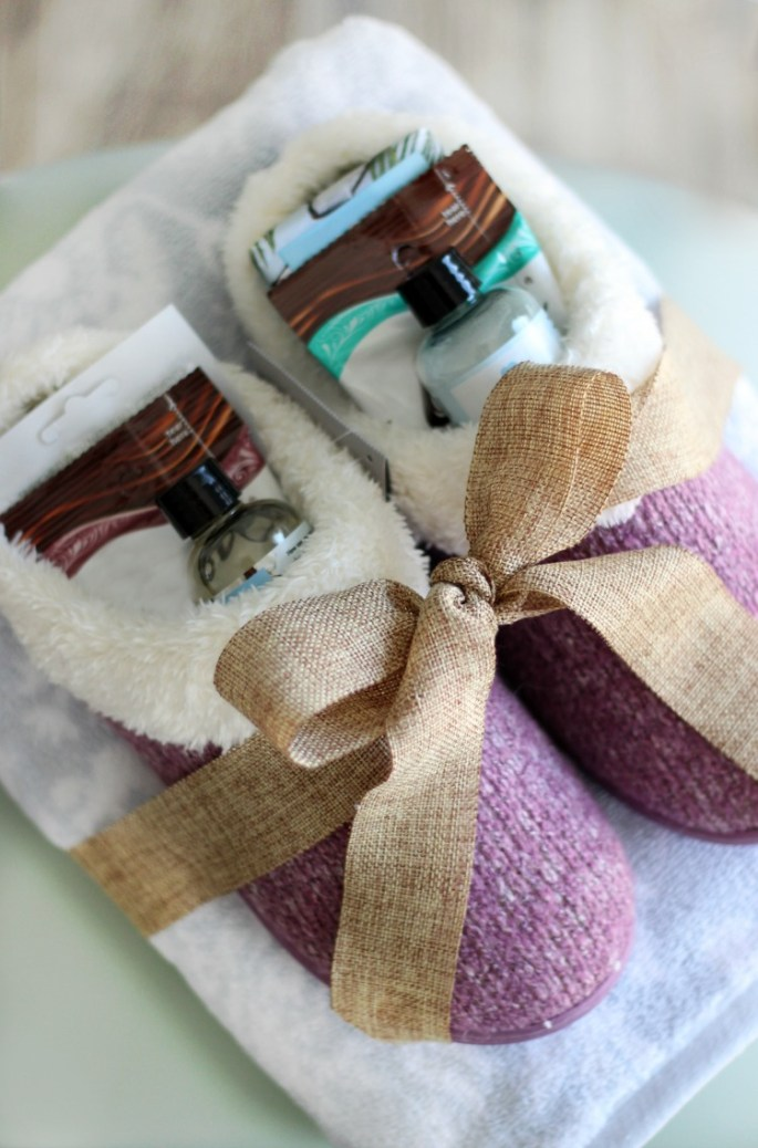 slippers on towel wrapped in a burlap ribbon for mothers day pampering gift