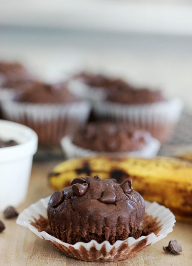chocolate banana muffin with open muffin wrapper