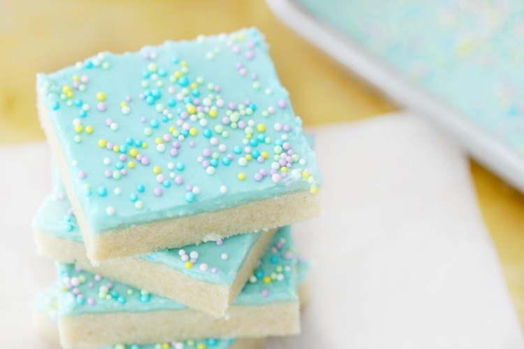 Easter sugar cookie bars are buttery, soft, and melt in your mouth delicious! Frosted with robin's egg colored frosting and add mini egg sprinkles!