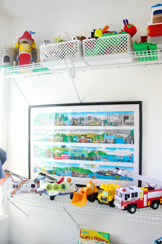 vehicle toys on shelf in creative toddler bedroom