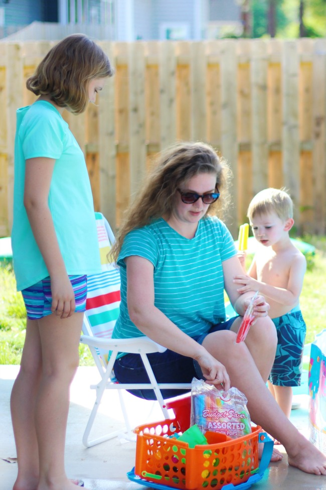 backyard activities for kids: mom and kids enjoying twin pops