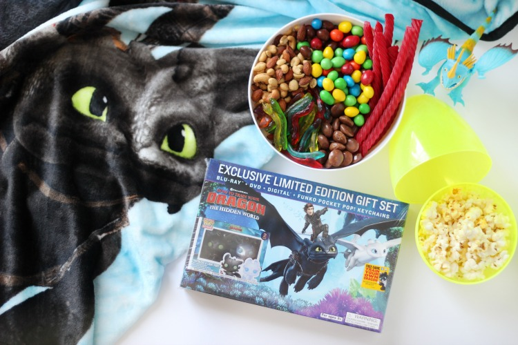 How to Train Your Dragon 3 DVD on table with movie snacks and popcorn
