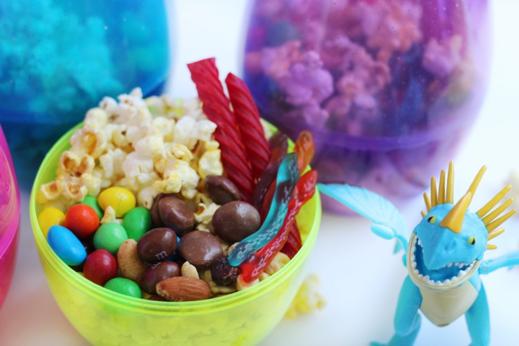 popcorn and candy in a snack cup with dragon toy
