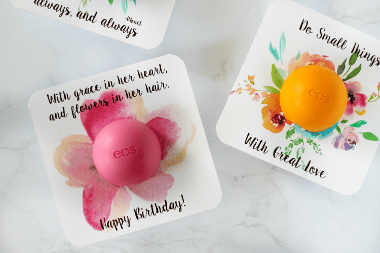 two finished EOS floral printables with lip balm attached