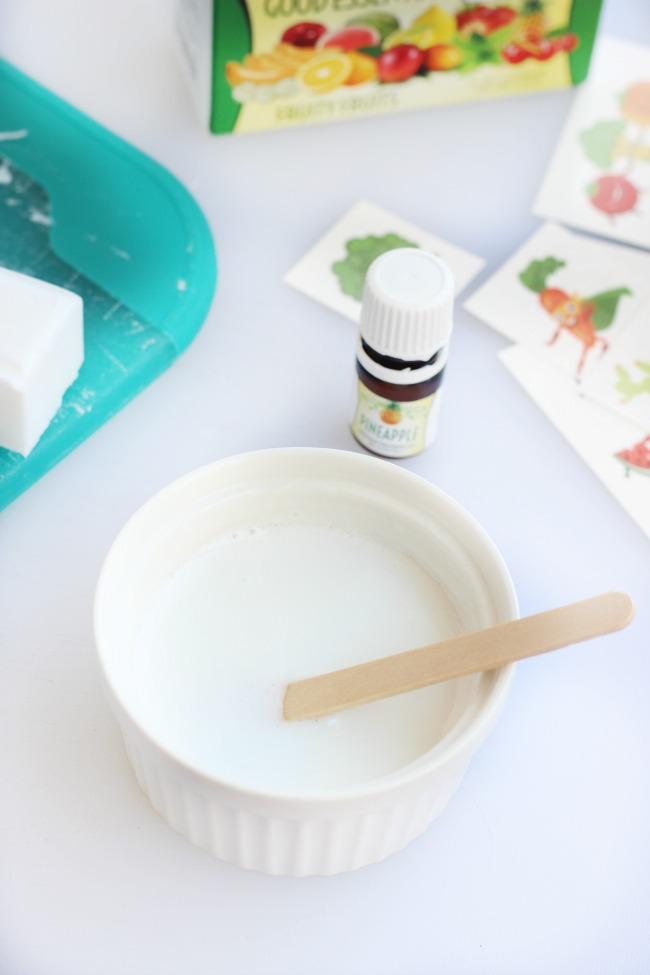 Melted soap in ramekin on table