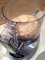 Oats, sesame seeds, and flax seeds to be processed.