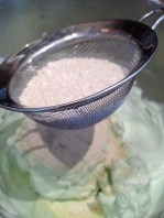 Sifting the sugar pistachio mix into the egg whites