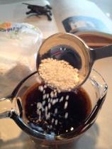 Adding the tapioca pearls to soak