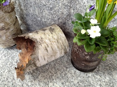 Birch sleeve and glass container