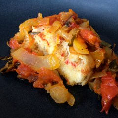 Breakfast topped with caramelized tomato compote