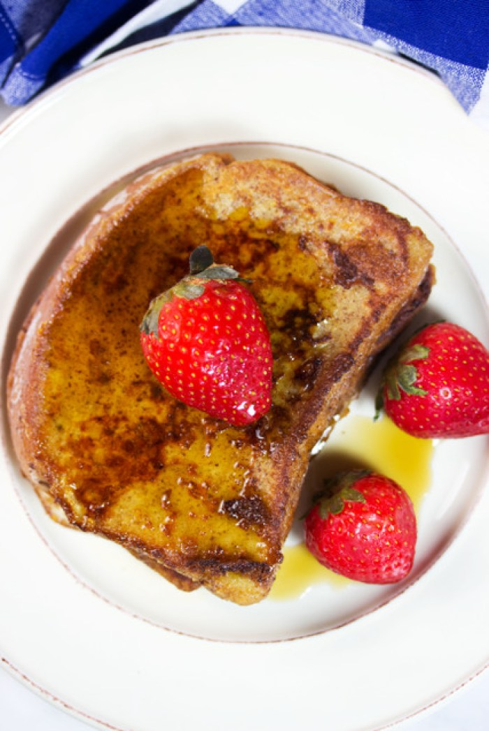 Gluten Free French Toast topped with strawberries and syrup