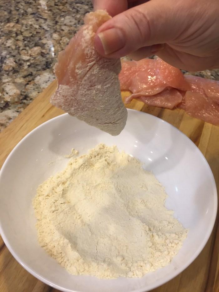 dredge chicken in flour