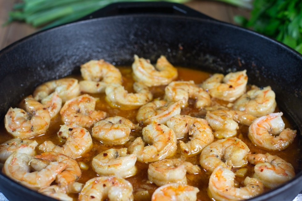 shrimp cooking in cast iron pan