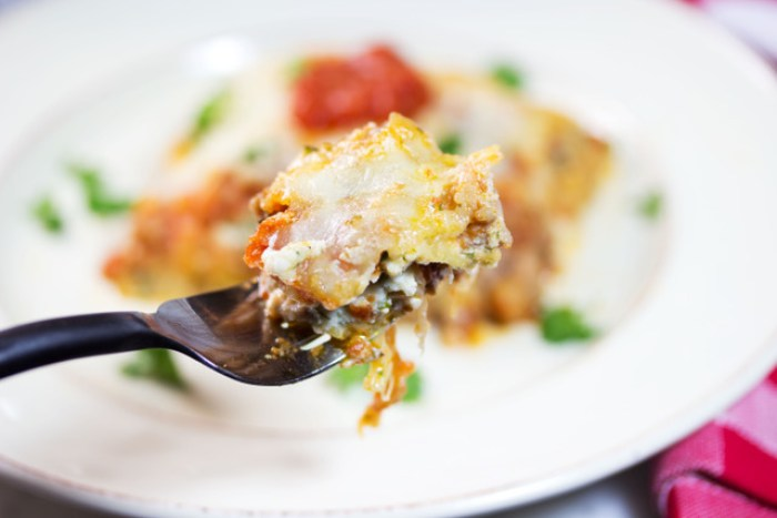 forkful of finished zucchini lasagna casserole