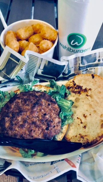 Wahlburgers hamburger and tater tots