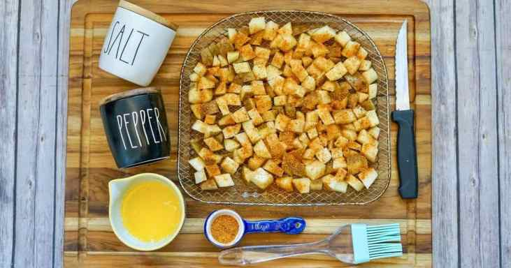 ingredients for air fryer cajun diced potatoes on cutting board