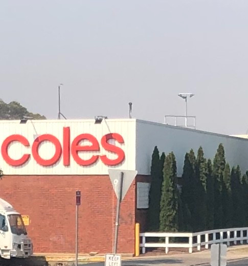 Coles sign on side of store