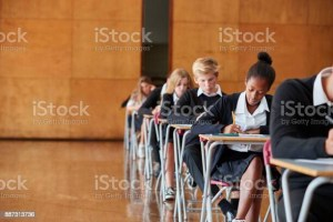 School students taking test in hall