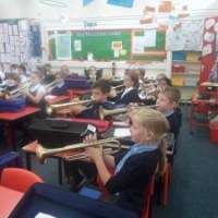 Year 4 love their trumpet lessons!