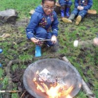 Year 2 A/C enjoy a Forest School taster session.
