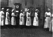 Female factory workers at Mather & Platt Ltd clocking off