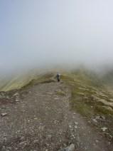 Bob heads down the ridge towards the bealach