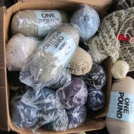 This is a pretty good sized box! It takes up half of the love seat. There must be at least 15 to 20 POUNDS Caron's ONE POUND yarn. Literally. :D