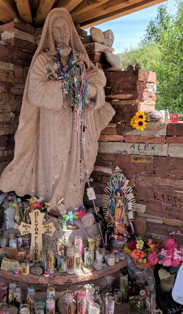 Statue hung with rosaries