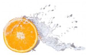 Vitamin C, symbol, orange slice through water