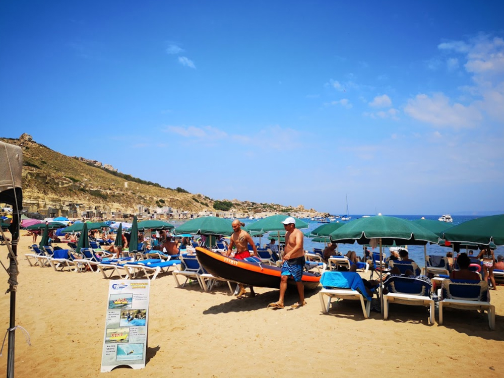 Umbrellas, sunbeds and deckchairs at Ġnejna