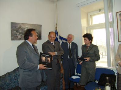 """The President of the Program Stavros Panousopoulos, donates the Collector's Edition """"Macedonia"""" to the General Consul of Greece in Moscow, Kontoleontos Iphigeneia. In the picture, in the middle from left, the MP of New Democracy Mr. Petros Mantouvalos and the President of the Hellenic Association in Moscow Mr. Sotidis Konstantinos"""