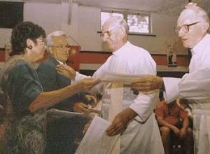 priests receiving evangelization certificates