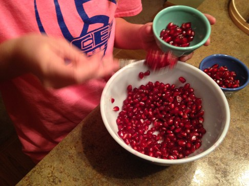 She sure loves her pomegranates. Our snack, along with popcorn, after doing pilates. It was a p-kinda-of-night.