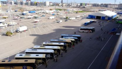 Buses lined up at the wharf for excursion groups
