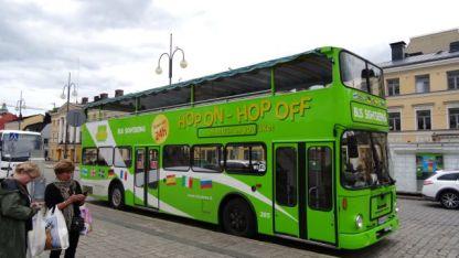 Green hop-on hop-off bus.