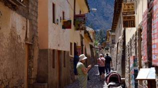 A narrow street full of guys houses for trekkers
