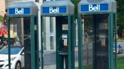 The telephone booths are scattered around the town.