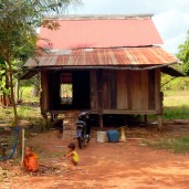 A young monk outside his home