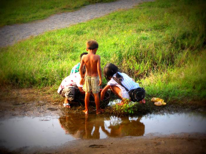 Cambodian children catching frogs