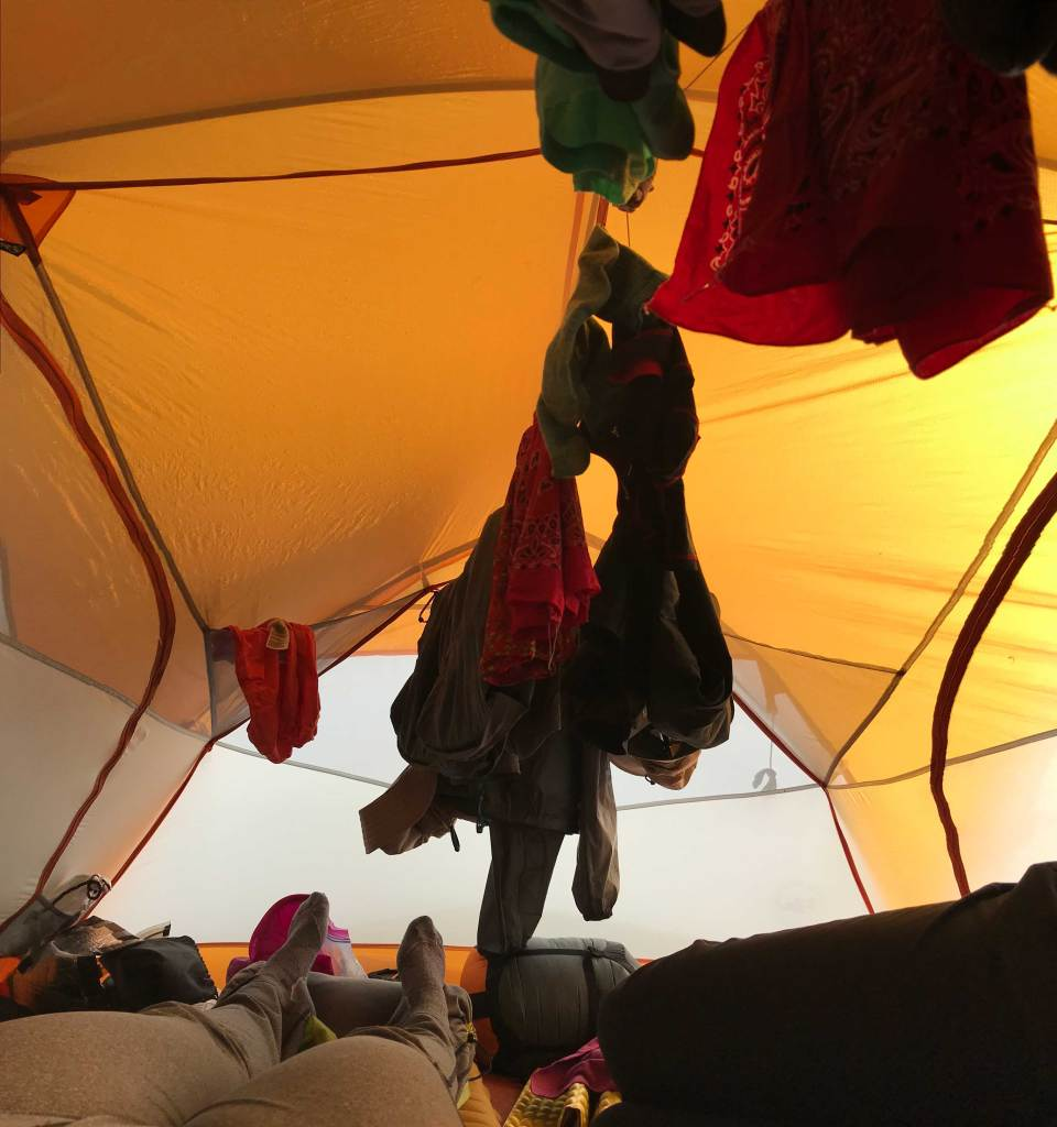 Rigging a clothesline inside the tent
