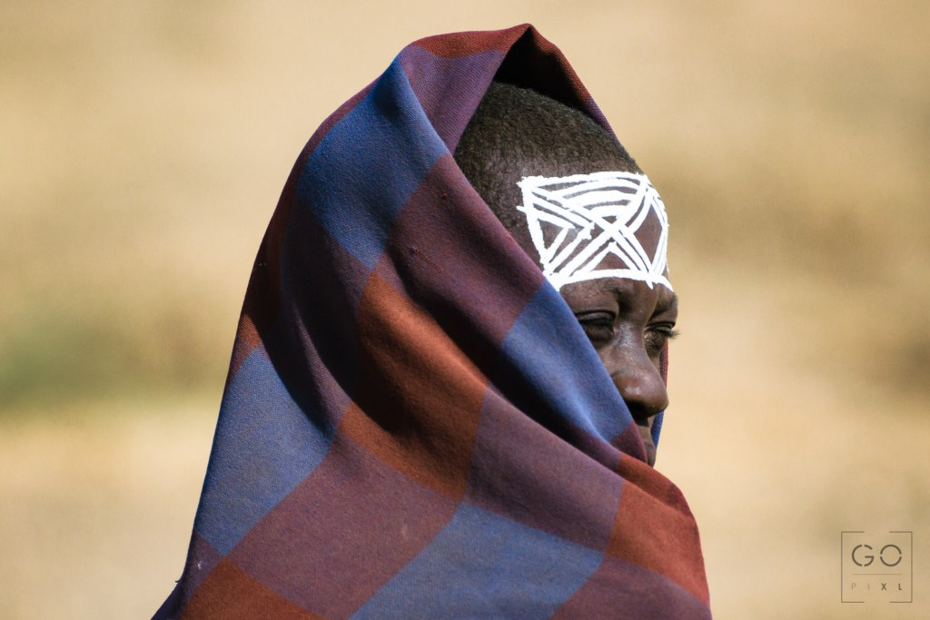 Maasai boy coming back home