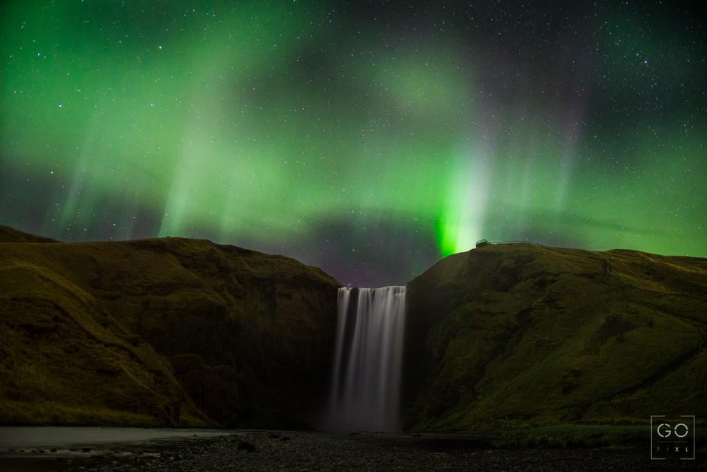 Auroras over Skogafoss, Iceland