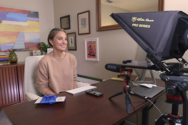 Emily filming tutorials on zoom doing 1x1 curling tutorials